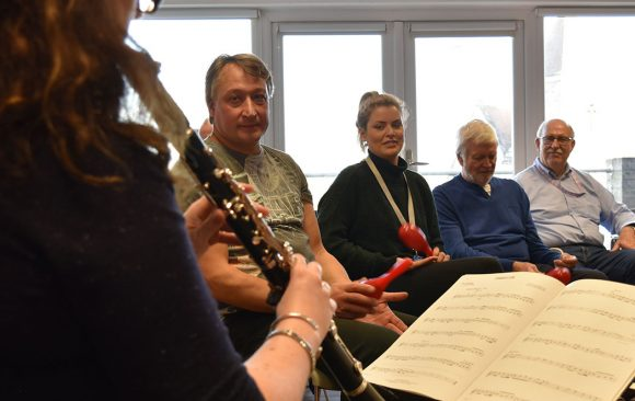 Rosie playing clarinet to Headway group participants