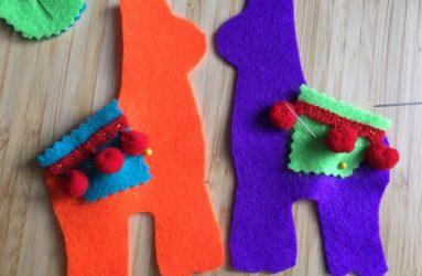 saddles pinned onto llama shapes