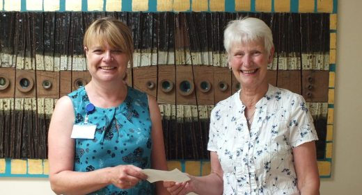 Loraine Sherlock handing cheque to Lesley Self