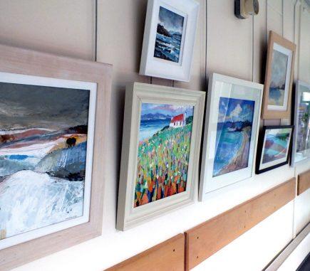 paintings hanging in corridor