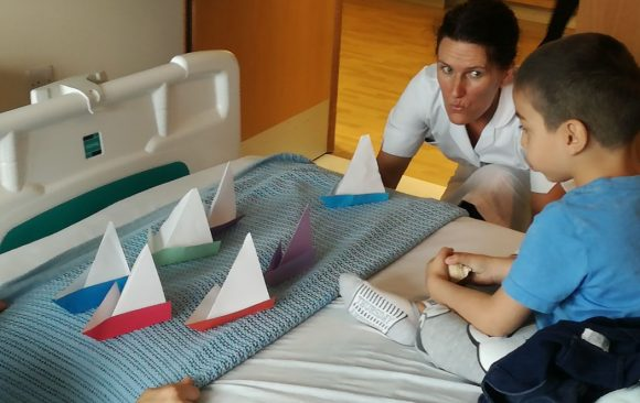 Origami boats on patients bed