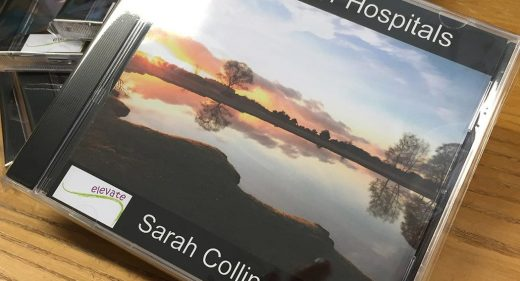 CD cover image of trees reflected in water