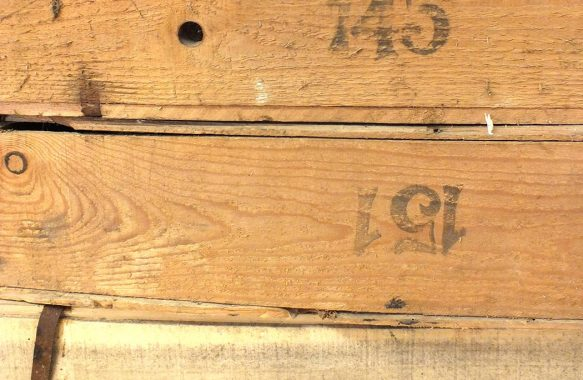 stamped numbers on sides of old wooden