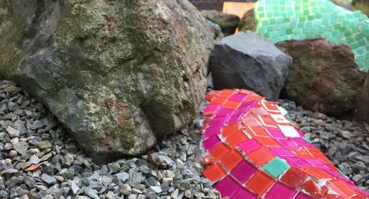 mosaic applied to rock in garden