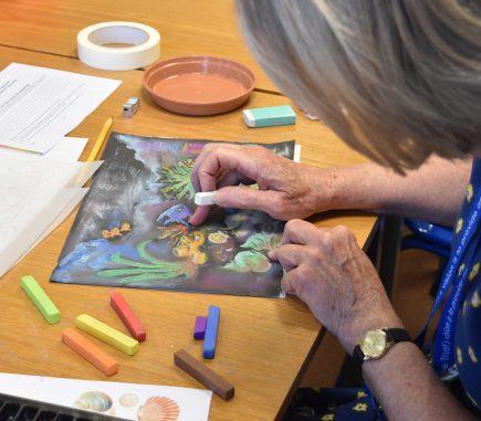 Staff member blending pastel image
