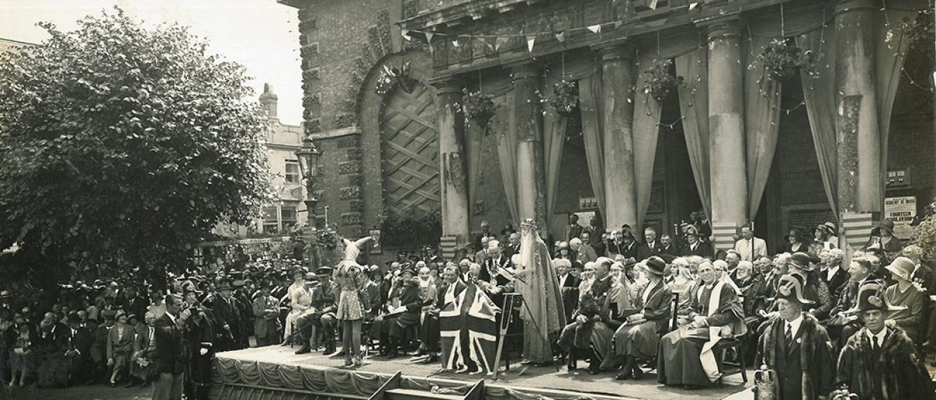 People dressed in carnival costumes on steps of Guildhall, Salisbury 1930
