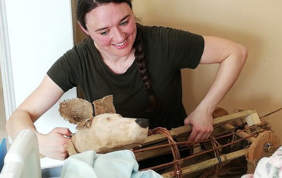 Anna with Shackleton dog puppet by patient bedside
