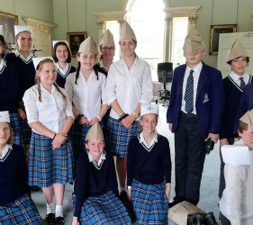 Pupils wearing the paper nurse and GI hats they have made