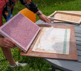 turning the paper pulp sheet out onto the couching cloth
