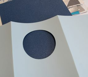 circle mount over blue textured paper