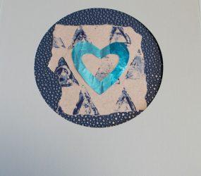 blue heart cutout on blue print background