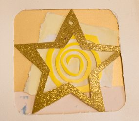 cut out gold star and yellow swirl abstract collage
