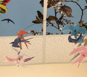 cut out bird silhouettes, laminated and suspended from wire