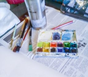 brushes, paints, palette, paper and water pot