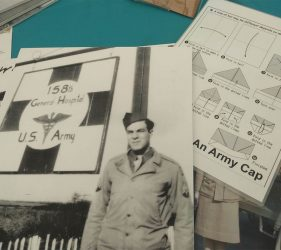 Archive photo of entrance to 5th General Hospital, paper army cap instructions