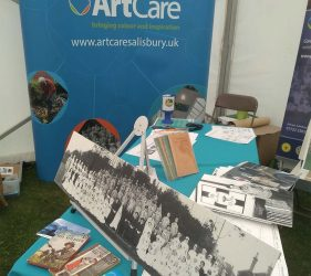 Copy WW1 photo, books and resources on table with ArtCare banner behind