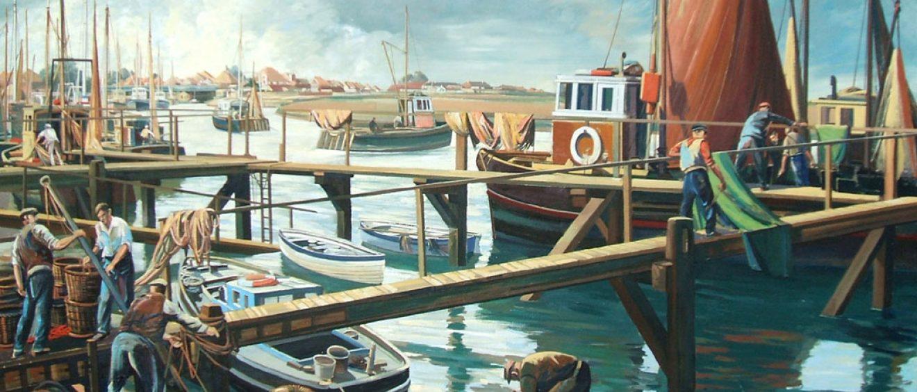 Fishermen unloading boats on wooden jetty