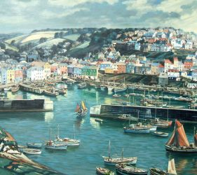 Mevagissey harbour with fishing boats and colourful houses stretching up the hillside