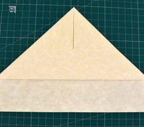 folding corners of bottom flap over