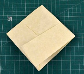 folded flat into square shape