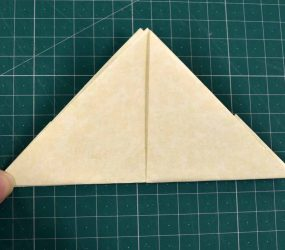 turn over and fold flap up to form triangle shape