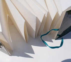 folded book left untied to show pages