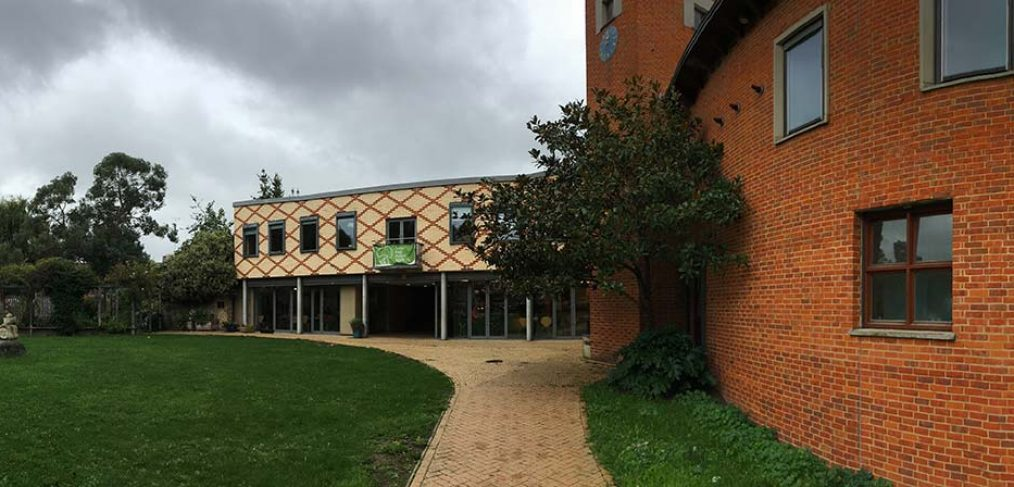 Modern brick building, pathway and grass