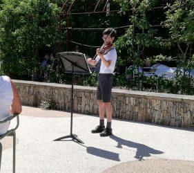 Boy playing violin in Horatio's Garden