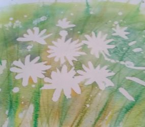 masking fluid removed to reveal white daisy shapes