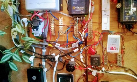 a tangle of multi-coloured wires leading from plugs to junction boxes and sockets of various kinds
