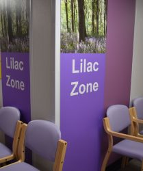 Lilac coloured seating with lilac wall panel and bluebell artwork