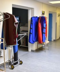 X-ray protection tunics hanging in waiting area with oxygen cylinder