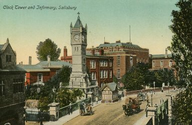 horse drawn carriages passing in front of clock tower early 20th century