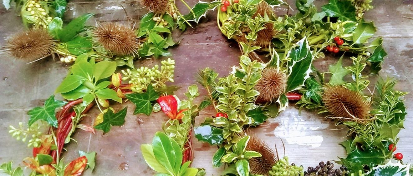 winter wreaths made of holly, leaves, teasel and berries