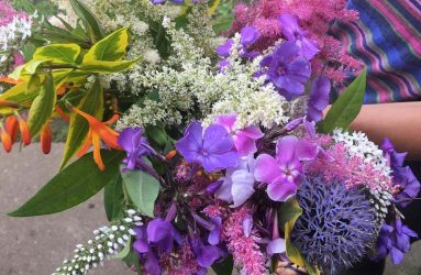 bunch of freshly picked pink, purple and white flowers