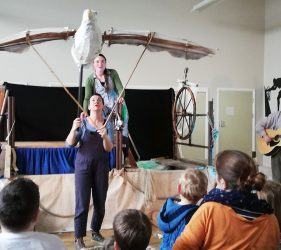 Performer controlling the wings of large Albatross puppet