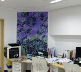 Abstract liver cell design artwork on wall behind desks