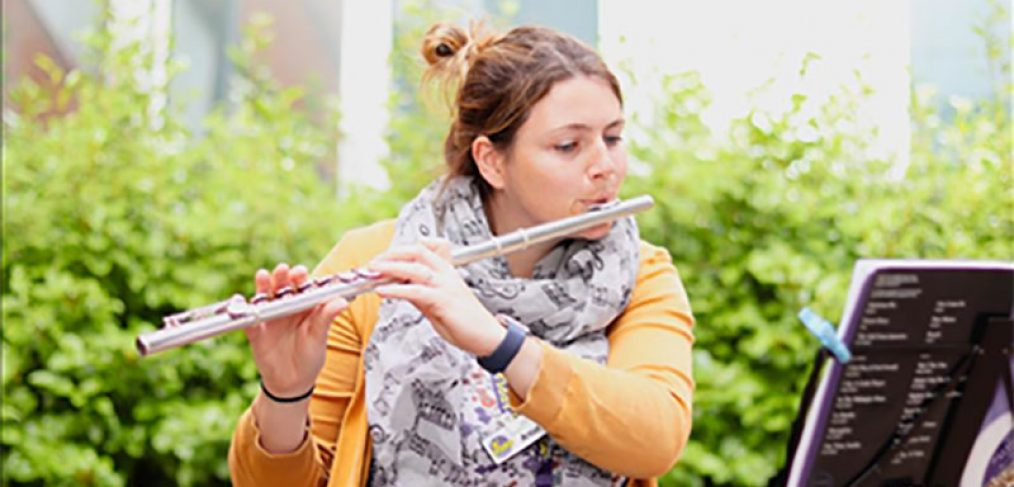 Alis playing flute in courtyard