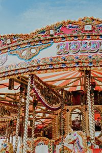 brightly coloured carousel with horses