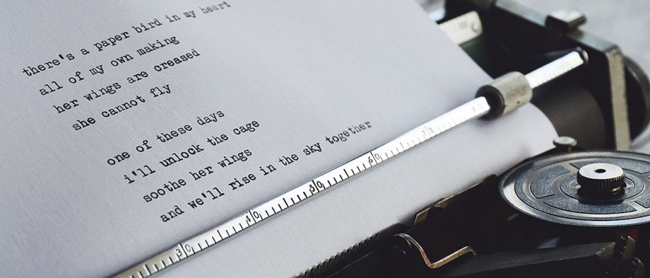 poem being typed on traditional typewriter