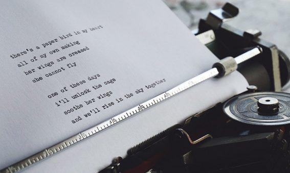 poem being typed on traditional typewriter