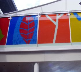 Play deck glass panels in bold colours, with relief cut outs of natural forms viewed from below
