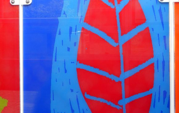 Bright blue glass with red leaf relief design