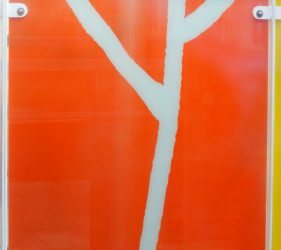 bright orange glass with white branch extending across the length