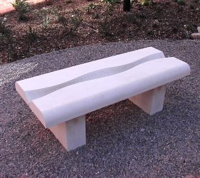 stone bench with a ripple shape and poetry carved along the central length