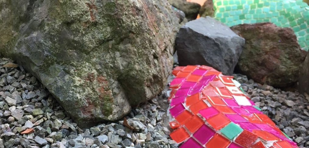 mosaic applied to rock in garden