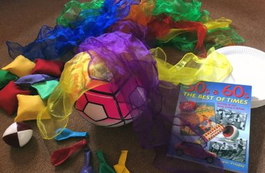 coloured scarves, balls, balloons, bean bags, paper plates and vintage themed book used in sessions