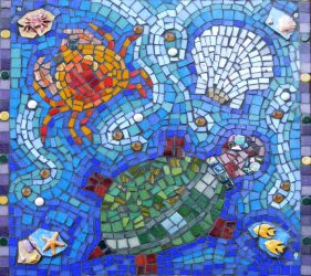 close up of mosaic with crab, turtle and shell