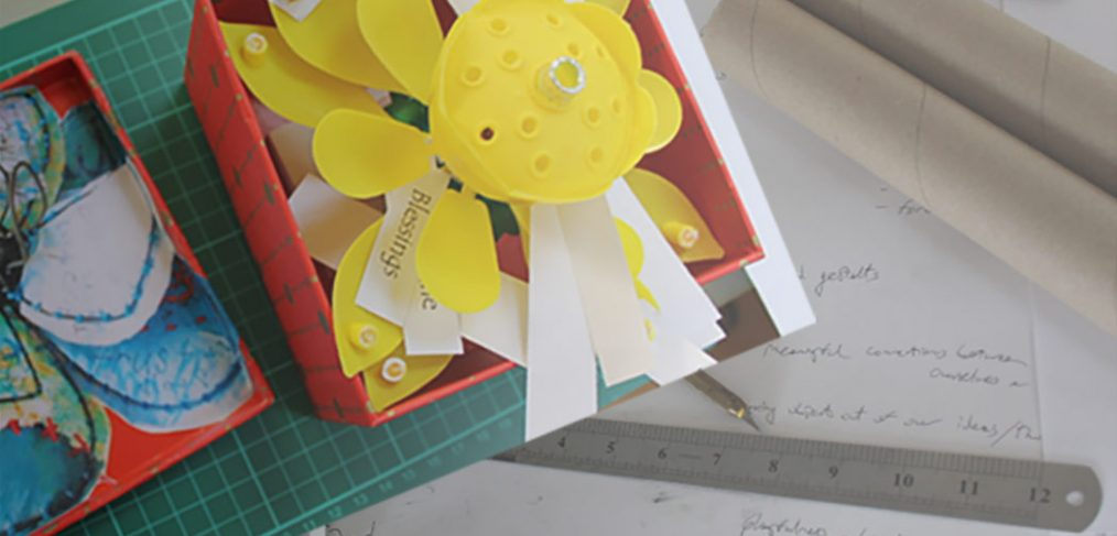 Jottings, pencil, paper and example memory box with words attached to model flower petals